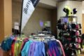 Reflective illumiNITE clothing on racks at the Expo.
